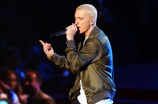 Eminem performs onstage at the 2014 MTV Movie Awards at Nokia Theatre on April 13, 2014 in Los Angeles.