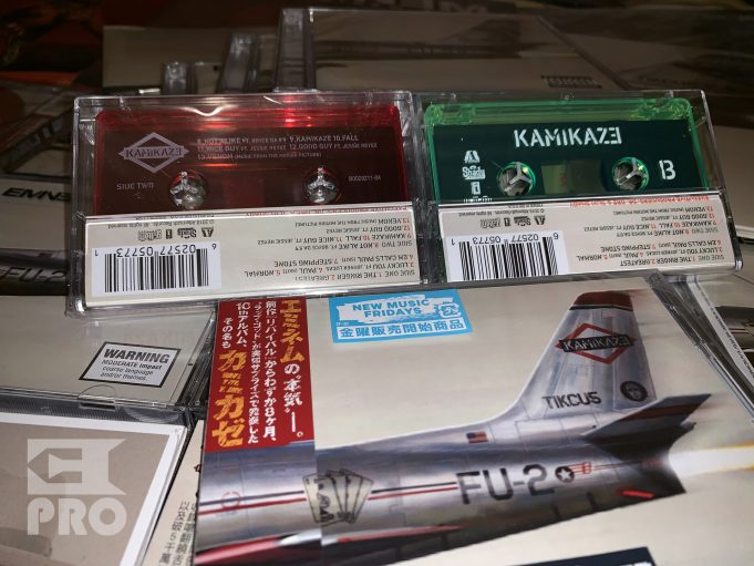 Unpacking of Kamikaze Night Combat glowing cassette with Eminem's autograph
