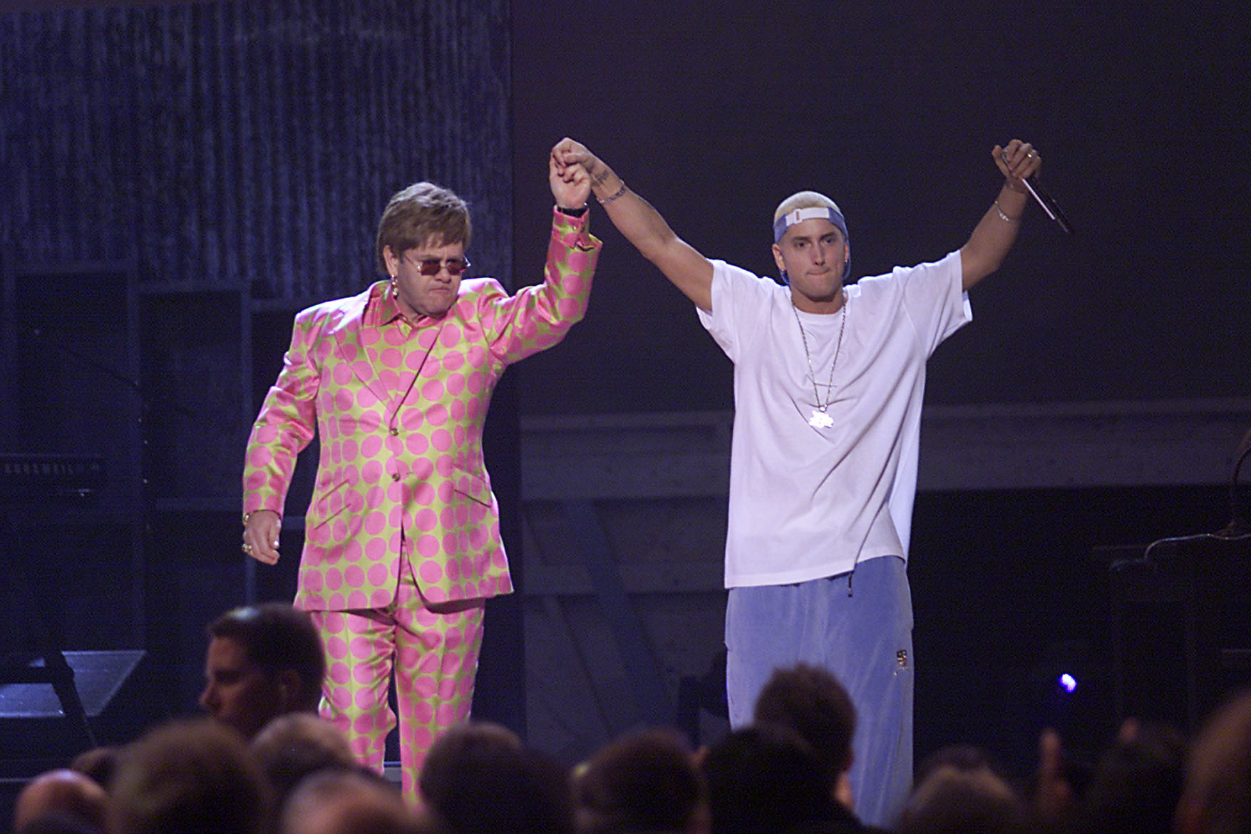 British singer Elton John (left) and American rap vocalist Eminem hold hands after their performance at The 43rd Annual Grammy Awards held at Staples Center, Los Angeles, California, February 21, 2001. (Photo by Frank Micelotta/Getty Images)