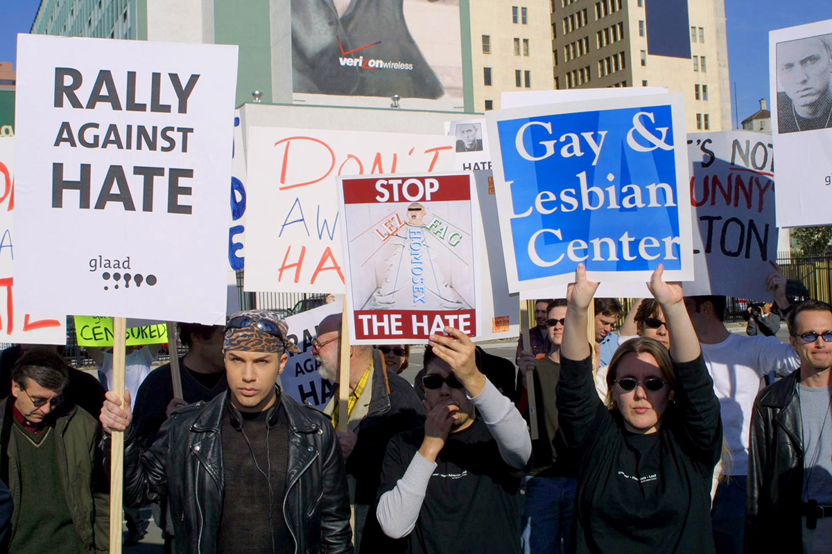 """385808 07: Protesters hold up signs during """"The Rally Against Hate"""" February 21, 2001 outside the Grammy Awards at the Staples Center in Los Angeles, CA as part of a protest against rapper Eminem's lyrics. (Photo by Jason Kirk/Newsmakers)"""
